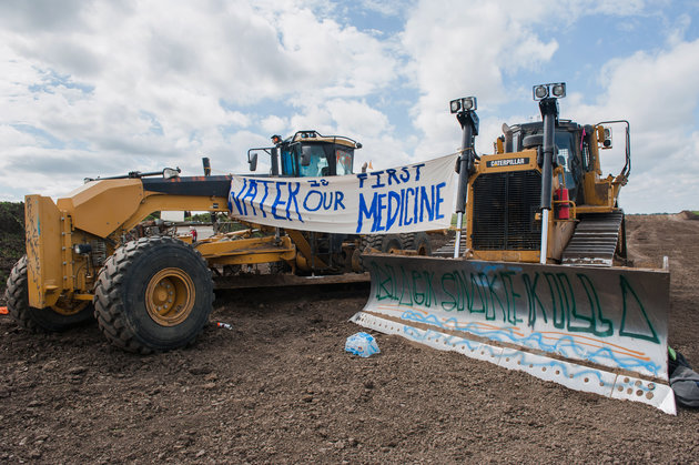 Signs hang from heavy machinery after protesters stopped construction on the Energy Transfer Partners Dakota Access oil pipeline near the Standing Rock Sioux reservation in Cannon Ball, North Dakota